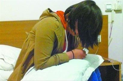小玉身上只剩下3毛钱,她也表示坚决不回家。 记者 姜旭 摄