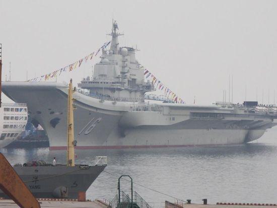 """9月23日,我国首艘航母""""16""""号昨日举行升旗仪式。"""