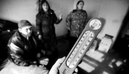 下午2时,温度计显示张家室内温度只有9℃