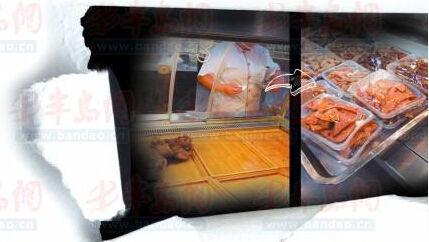 柜台工作人员把价签撕掉 撕掉价签的盒装熟食
