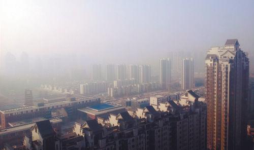 10月10日清晨,长白岛地区的楼宇笼罩在一片雾霾之中。
